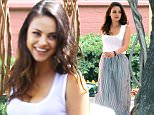 *PREMIUM EXCLUSIVE* **MUST CALL FOR PRICING** Burbank, CA - Actress Mila Kunis is beaming in new bride bliss as she visits Disney Studios today for a work engagement.  The newly wedded Mrs. Kutcher looks fabulous in a white tank top and maxi skirt for a warm day in the valley.  Mila shared a sweet smile with a young man passing buy before hopping in her car to head home for the afternoon.\n  \nAKM-GSI       July 20, 2015\n**MANDATORY CREDIT MUST READ: FameFlynet/AKM-GSI**\nTo License These Photos, Please Contact :\nSteve Ginsburg\n(310) 505-8447\n(323) 423-9397\nsteve@akmgsi.com\nsales@akmgsi.com\nor\nMaria Buda\n(917) 242-1505\nmbuda@akmgsi.com\nginsburgspalyinc@gmail.com