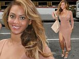 ***MANDATORY BYLINE TO READ INFPhoto.com ONLY***\nBeyonce was seen arriving to her midtown Manhattan office wearing a nude thigh high slit dress, New York City.\n\nPictured: Beyonce\nRef: SPL1084426  210715  \nPicture by: T.Jackson/INFphoto.com\n\n