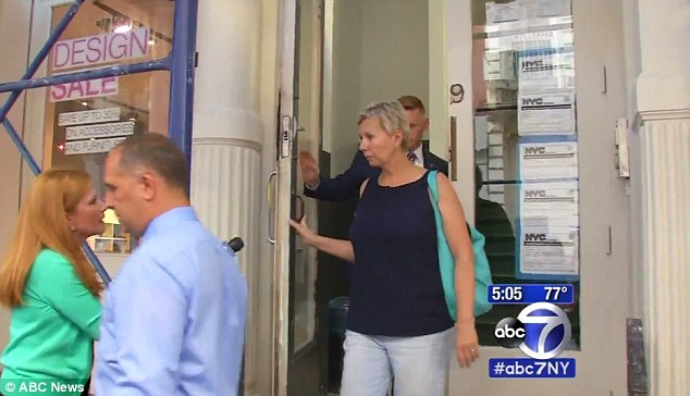 Questioned: The day care center owner,Maryellen Strautmanis, was escorted away by NYPD for an interview on Tuesday afternoon