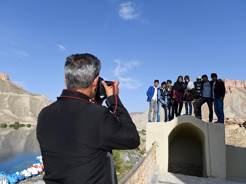 A photographer taking a picture of Afghan youths near Band-i-Amir Lake in the central Afghan province of Bamiyan. (AFP Photo)