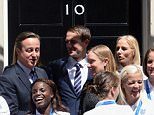 Members of England Women's  Football team stand on the steps of 10 Downing Street, London, with Prime Minister David Cameron after a reception. PRESS ASSOCIATION Photo. Picture date: Thursday July 9, 2015. The Lionesses finished the tournament, staged in Canada, as Europe's top side after their 1-0 third-place play-off win over Germany in Edmonton at the weekend. See PA story ROYAL William. Photo credit should read: Stefan Rousseau/PA Wire