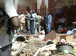 Soldiers and police forces stand guard at a market in N'Djamena following a suicide bomb attack on July 11, 2015 ©Brahim Adji (AFP/File)
