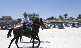 FILE - In this June 28 2015 file photo, mounted police officers patrol on the beach of  Sousse, Tunisia. The blood on the sand has washed away, but the damage wreaked on Tunisia by a few terrifying minutes of gunfire at a beach resort will be deep and lasting. The tourist economy is likely to be gutted: Up to 2 million hotel nights per year are expected to be lost, hastened by warnings from Britain and other European governments last week that their citizens are no longer safe on . (AP Photo/Abdeljalil Bounhar, File)