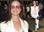 Juliette Lewis in costume wearing bright pink make-up under her eyes and a swim suit under her white suit was seen arriving to do her show at the 'EL Rey Theatre' in Los Angeles, CA\n\nPictured: Juliette Lewis\nRef: SPL1085686  230715  \nPicture by: SPW / Splash News\n\nSplash News and Pictures\nLos Angeles: 310-821-2666\nNew York: 212-619-2666\nLondon: 870-934-2666\nphotodesk@splashnews.com\n