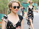 EXCLUSIVE: Rachel McAdams wears a floral black dress while enjoying the nice weather in SoHo, New York City  Pictured: Rachel McAdams Ref: SPL1085849  230715   EXCLUSIVE Picture by: Felipe Ramales / Splash News  Splash News and Pictures Los Angeles: 310-821-2666 New York: 212-619-2666 London: 870-934-2666 photodesk@splashnews.com