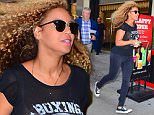 Beyonce was spotted out in NYC , looking completely casual. She wore a see through black t shirt, black jeans and converse sneakers. She ran through the tourists in Times Square, attempting to go unseen. She dashed past a large Happy Hour sign, with her hair flowing in the breeze\n\nPictured: Beyonce\nRef: SPL1084420  220715  \nPicture by: 247PAPS.TV / Splash News\n\nSplash News and Pictures\nLos Angeles: 310-821-2666\nNew York: 212-619-2666\nLondon: 870-934-2666\nphotodesk@splashnews.com\n