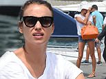 EXCLUSIVE Irina Shayk is seen the morning after Leonardo Dicaprio's party in saint tropez, looking make up free and seen with a few spots to her forehead, the russian model was keen not to be photographed and covered up with a large hat over her face. 23 July 2015. Please byline: Vantagenews.co.uk