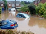 Under water: Thousands of motorists have had their cars conk out in the past few weeks after driving through flooded roads