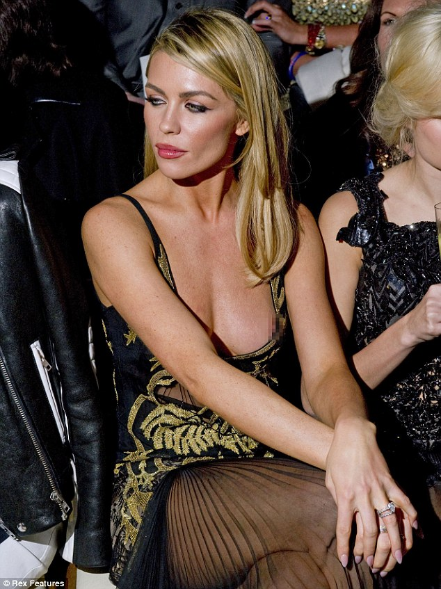 Peek-a-boo! Abbey Clancy experienced an accidental wardrobe malfunction when she suffered a nip-slip as the unforgiving fabric of the gown came away from her chest at London Fashion Week on Saturday