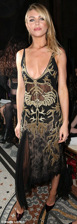 Sheer daring: Abbey Clancy and Millie Mackintosh ensured all eyes were on the front row as they attended Julien Macdonald's London Fashion Weeek AW14 show on at The Royal Courts of Justice on Saturday afternoon