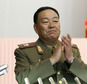 File-This July 18, 2012, file photo shows Vice Marshal Hyon Yong Chol applauding during a meeting announcing North Korean leader Kim Jong Un's new title of marshal, in Pyongyang, North Korea.  North Korea has officially confirmed the purging of its defense chief two months after Seoul's spy service said he had been executed for disloyalty to leader Kim Jong Un, a South Korean official said Monday, July 12, 2015. South Korea's National Intelligence Service told lawmakers in May that People's Armed Forces Minister Hyon Yong Chol was killed by anti-aircraft gunfire for talking back to Kim, complaining about his policies and sleeping during a meeting. (AP Photo/Jon Chol Jin, File)