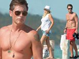 July 25th, 2015 - Saint Tropez\n****** Exclusive Picture ******\nThe 50-year-old Rob Lowe shows his impressive physique as he arrives with his wife Sheryl Berkoff at the Club 55 in Saint Tropez.\nSheryl takes very care of her husband look is impeccable as they arrive at the famous beach. She immediately puts in place the label who accidentally exceed from her husband's short.\n****** BYLINE MUST READ : © Spread Pictures ******\n******Please hide the children's faces prior to the publication******\n****** No Web Usage before agreement ******\n****** Stricly No Mobile Phone Application or Apps use without our Prior Agreement ******\nEnquiries at photo@spreadpictures.com