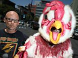 "LOS ANGELES, CA - JULY 24:  Recording artist Moby and Mercy for Animals protest with seven-foot-tall ""Abby the Abused Chicken"" on July 24, 2015 in Los Angeles, California.  (Photo by David Livingston/Getty Images)"