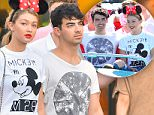 EXCLUSIVE: Joe Jonas and his new girlfriend Gigi Hadid spend a day at Disneyland having a super fun date. Joe and Gigi spent the day holding hands, and riding different rides through the park including Space Mountain,  it's a small world, splash Mountain, the haunted mansion and the Jungle Cruise. they were joined by a couple of friends, two bodyguards and a disneyland tour guide. \nThe pair seemed very happy spending time with each other constantly smiling hand holding hands while walking\n\nPictured: Joe Jonas and Gigi Hadid\nRef: SPL1086180  250715   EXCLUSIVE\nPicture by: Fern /  Splash News\n\nSplash News and Pictures\nLos Angeles: 310-821-2666\nNew York: 212-619-2666\nLondon: 870-934-2666\nphotodesk@splashnews.com\n