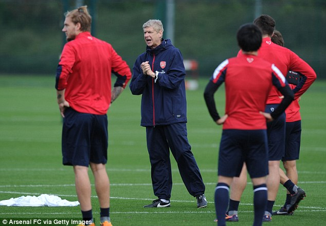 Instructions: Arsene Wenger shouts out during Arsenal's training session before they face Crystal Palace