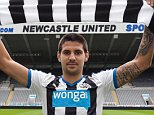 NEWCASTLE UPON TYNE, ENGLAND - JULY 20: (EXCLUSIVE COVERAGE) Aleksandar Mitrovic holds a Newcastle United Shirt in the tunnel at St.James' Park after signing for the club on July 20, 2015, in Newcastle upon Tyne, England. (Photo by Serena Taylor/Newcastle United via Getty Images)