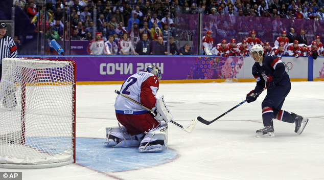 History in the making: USA forward T.J. Oshie scores the winning goal against Russia goaltender Sergei Bobrovski in a shootout during overtime of a men's ice hockey game at the 2014 Winter Olympics