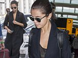 Picture Shows: Selena Gomez  July 28, 2015\n \n A casual Selena Gomez is seen arriving at Heathrow Airport in London, UK. Selena wore a black duster coat, black tights and navy boots.\n \n Non Exclusive\n WORLDWIDE RIGHTS\n \n Pictures by : FameFlynet UK © 2015\n Tel : +44 (0)20 3551 5049\n Email : info@fameflynet.uk.com