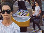 EXCLUSIVE: Katie Holmes spotted wearing stripes while hailing a taxi cab in NYC\n\nPictured: Katie Holmes\nRef: SPL1086862  270715   EXCLUSIVE\nPicture by: J. Webber / Splash News\n\nSplash News and Pictures\nLos Angeles: 310-821-2666\nNew York: 212-619-2666\nLondon: 870-934-2666\nphotodesk@splashnews.com\n