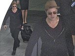 Picture Shows: Brad Pitt  July 27, 2015\n \n American actor Brad Pitt is spotted arriving at Heathrow Airport in London, England.\n \n The fifty-one year-old star was dressed down in a black sweatshirt, black jeans, sunglasses and a brown fedora as he wheeled his own luggage through the terminal.\n \n Non Exclusive\n WORLDWIDE RIGHTS\n \n Pictures by : FameFlynet UK © 2015\n Tel : +44 (0)20 3551 5049\n Email : info@fameflynet.uk.com