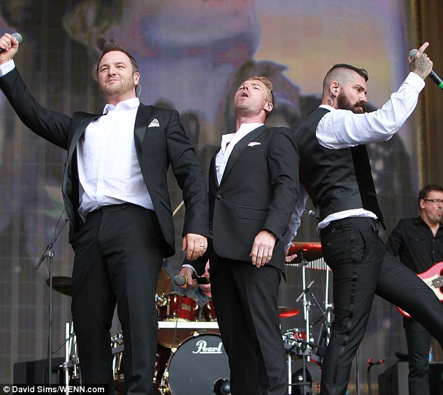 Dancing shoes: The boys all looked dapper in black and white suits for their performance