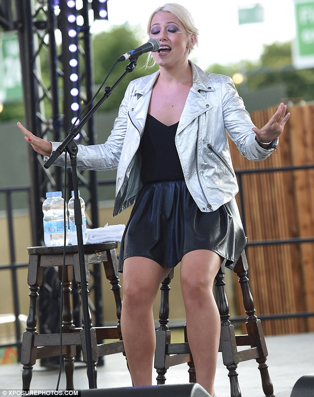 Hot metal: X Factor contestant Amelia Lily performed in a silver jacket and leather look skirt