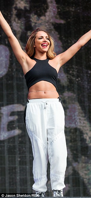 Belly dancers: both Jade (left) and Perrie (right) wore tummy flashing crop tops for their performance