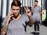 "UK CLIENTS MUST CREDIT: AKM-GSI ONLY\nEXCLUSIVE: Los Angeles, CA - ""Orange Is The New Black"" star Ruby Rose flashes a peace sign as she runs a few errands in Los Angeles this afternoon.\n\nPictured: Ruby Rose\nRef: SPL1087500  250715   EXCLUSIVE\nPicture by: AKM-GSI / Splash News\n\n"