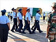 Indian Air Force and Indian Army officials carry a casket bearing former Indian President APJ Abdul Kalam's body