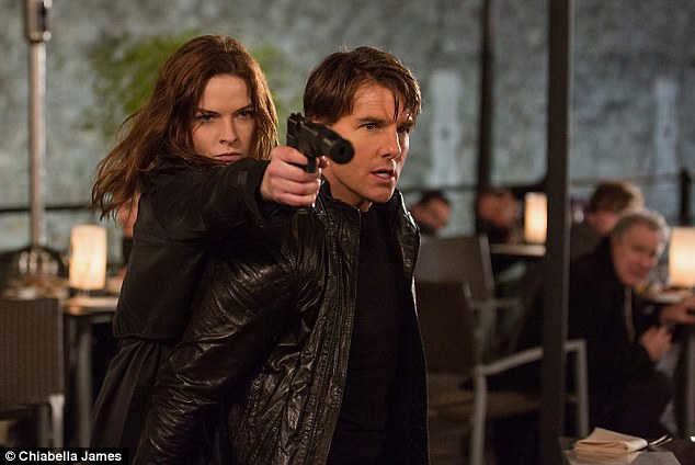 Back at it: Tom returns as IMF agent Ethan Hunt, alongside Rebecca Ferguson (pictured) in Mission: Impossible - Rogue Nation, which hits theaters July 31