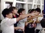 """Pic shows: Photos of the incident were posted on social media. A group of mainland Chinese tourists have been detained by police for allegedly attacking the ground crew of a flight bound for the countryís capital after their plane was delayed for several hours. According to reports coming from Hong Kong International Airport, six tourists from the Chinese mainland ñ three men and three women ñ were arrested for physically assaulting seven crew members of their Beijing-bound flight. Reports said the Hong Kong Airlines flight had been delayed for more than six hours, angering the tourists, aged between 21 and 42, who took out their frustrations on the ground crew at around 2.30am local time. Three men and four women from the airlinesí ground staff were taken to North Lantau Hospital for treatment of minor injuries as a result of the altercation. A Hong Kong Airlines spokeswoman said: """"The flight was delayed because of air traffic control in Beijing."""" She continued: """"A woman from the gro"""