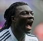 SWANSEA, WALES - APRIL 04: Bafetimbi Gomis of Swansea City celebrates his goal during the Barclays Premier League match between Swansea City and Hull City at Liberty Stadium on April 04, 2015 in Swansea, Wales.  (photo by Athena Pictures/Getty Images)
