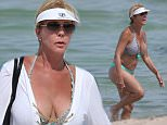 140640, EXCLUSIVE: Real Housewives of Orange County star Vicki Gunvalson wears a green and blue bikini to the beach in Miami. Vicki, who is an original cast member of the hit Bravo reality show, clad in a small bikini, showed she's fit at 53 as she took a dip in the ocean with a friend. The reality star paid tribute to the community that made her famous, with her white 'Coto de Caza' sun visor . Miami, Florida - Tuesday July 28, 2015. Photograph: Brett Kaffee © Pacific Coast News. Los Angeles Office: +1 310.822.0419 sales@pacificcoastnews.com FEE MUST BE AGREED PRIOR TO USAGE