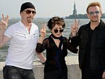 NEW YORK, NY - JULY 29:  (L-R) The Edge, Yoko Ono and Bono attend Amnesty International Tapestry Honoring John Lennon Unveiling at Ellis Island on July 29, 2015 in New York City.  (Photo by Kevin Mazur/WireImage)