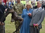 29.07.15 Charles The Prince Wales, Patron  and Camilla The Duchess of Cornwall visit the The 134th Sandringham Flower Show at  Sandringham Estate Norfolk their meet Zephyr the 4 year old Bald Eagle