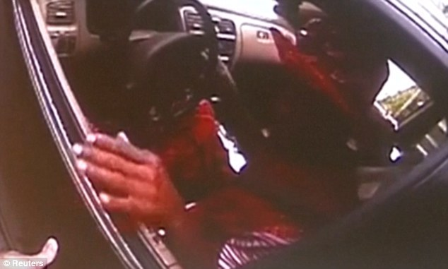 The confrontation started when Tensing pulled DuBose over for not having a front licence plate. They are seen talking to each other through the driver's side window