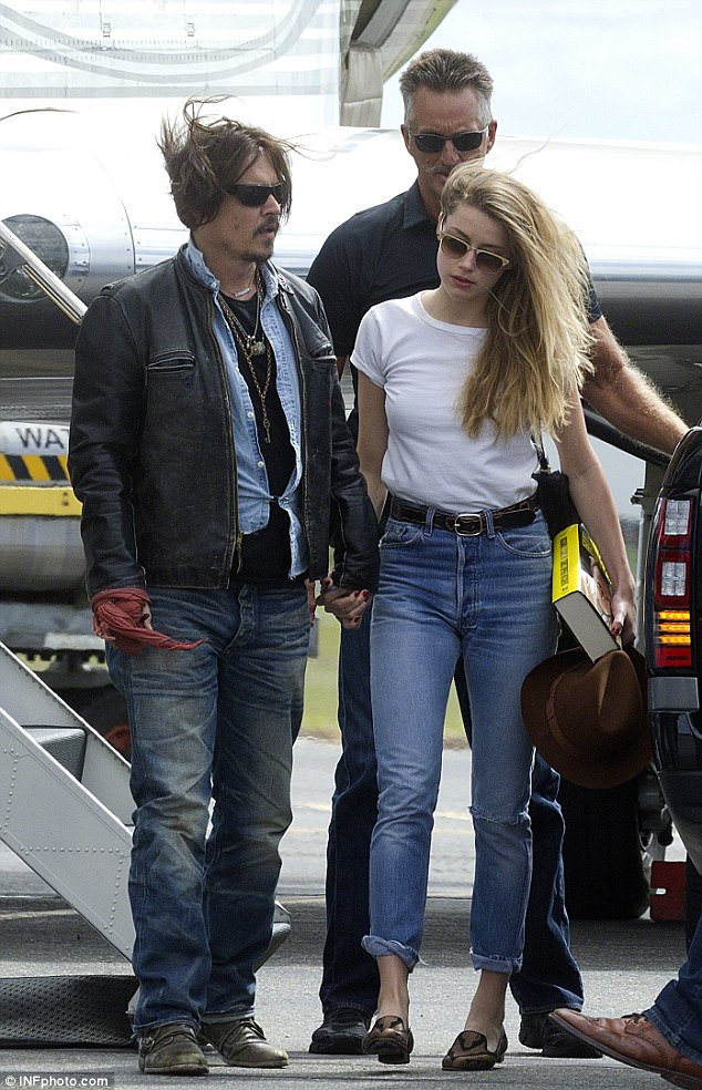 Usual look: The 52-year-old (seen here with wife Amber Heard in April) usually has lots of dark brown hair but in the film sports thin white locks with a receding hairline