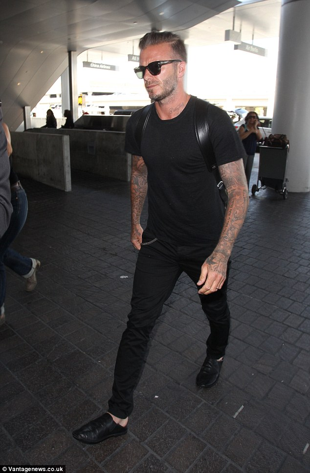 Casual figure: He wore all black, attempting to go incognito, though it didn't work