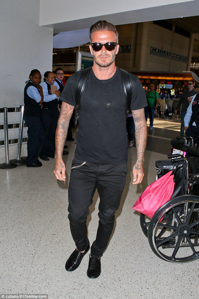 Sartorial slip up? David Beckham headed through LAX airport on Wednesday afternoon in a pair of slippers
