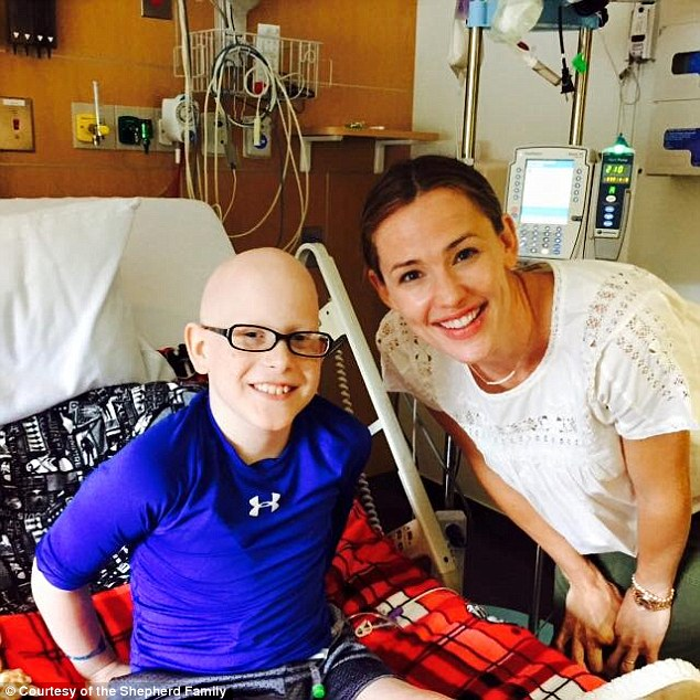 Making his day: On Sunday, Jennifer visited a nine-year-old boy who is undergoing chemotherapy at a local hospital