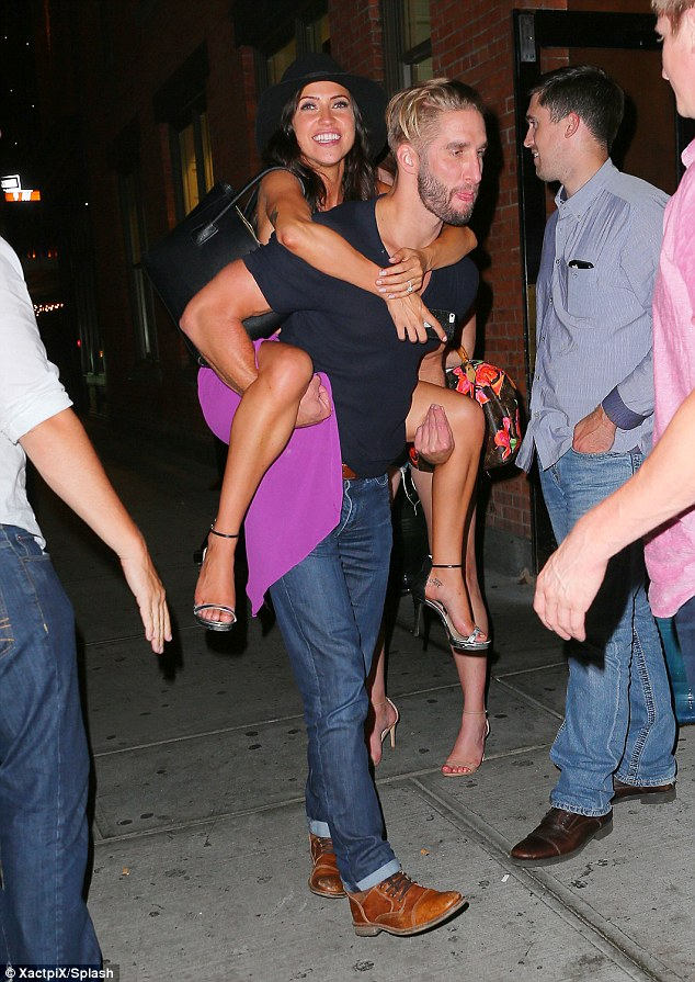 They support each other! Booth playfully gave his leading lady a piggy back ride in New York City on Tuesday