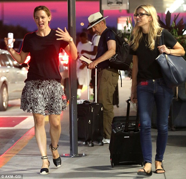Great to see you: Jennifer perked up after picking up her friend, and they chatted animatedly while heading to her car