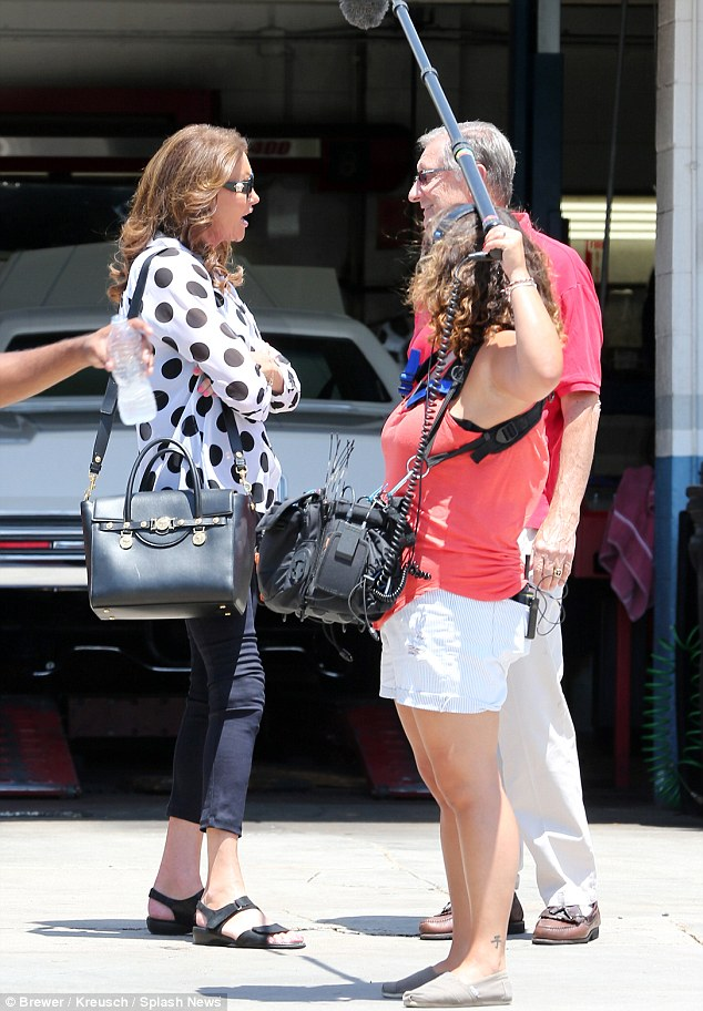 Ready for her close-up! The two-time Olympic gold medalist finished her casual attire with cropped skinny trousers, black sandals, and a large matching purse