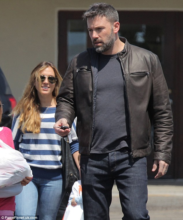 Explosive claims: Ben has denied he is romantically involved with his children's nanny, who he is pictured with in May