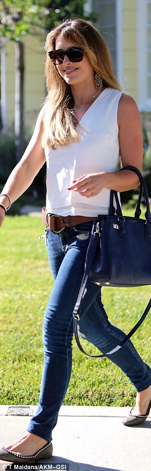A wide brown belt with a large buckle added a fashion forward look