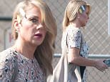 July 29, 2015: Christina Applegate arrives at 'Jimmy Kimmel Live!' in a pretty white floral designed dress, Los Angeles, CA.\nMandatory Credit: INFphoto.com Ref.: infusla-300