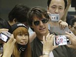 Actor Tom Cruise has his picture taken with a fan as he arrives to promote his latest movie ìMission Impossible: Rogue Nationî at the Incheon International Airport, South Korea, Thursday, July 30, 2015. (AP Photo/Ahn Young-joon)