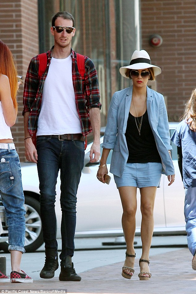 Stroll: Nicole wore a slick of red lipstick and barely there make-up for her stroll with her friend, while her companion was wearing a plaid shirt with a white T-shirt