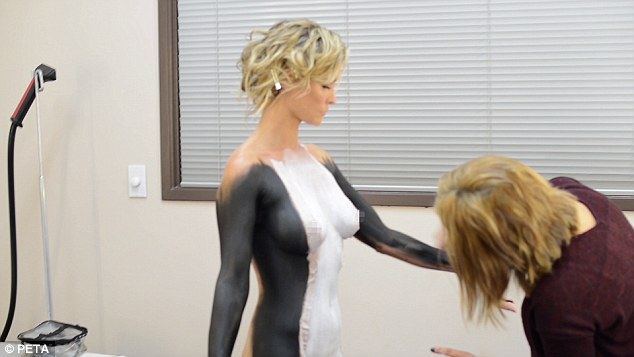 Exposing: The pretty blonde pinned her blonde locks out of the way as she's seen getting ready for the PETA shoot