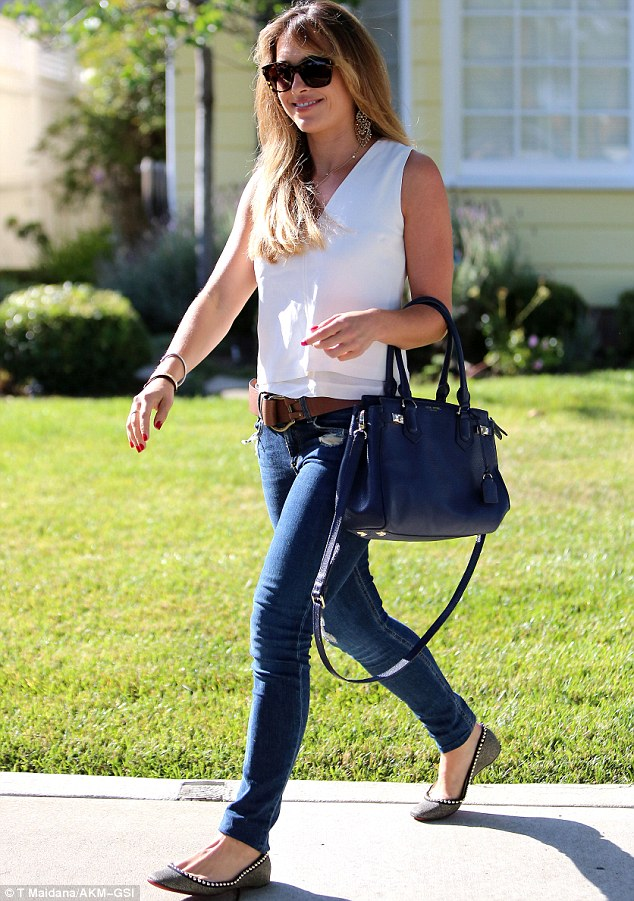Relaxed: She wore a pair of flat shoes and finished off the look with a navy leather bag